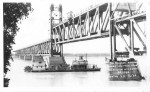 """The Douglas"" passing under uplifted span meridian highway bridge, Yankton, S.D."